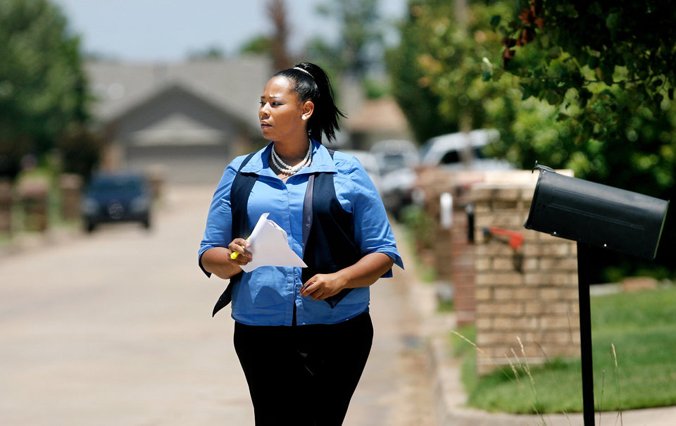 Candidate Zana Williams holds a list of district voters as she canvasses a southeast Oklahoma City neighborhood, meeting residents and seeking their votes in July\'s primary election. This is Williams\' first run at public office. Tuesday, June 22, 2010. Photo by Jim Beckel, The Oklahoman