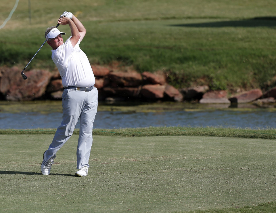 Photo - Colin Montgomerie hit off the tee on the 17th hole in a 3-hole playoff in the final round of the U.S. Senior Open golf tournament at Oak Tree National in Edmond, Okla., Sunday, July 13, 2014. Photo by Sarah Phipps, The Oklahoman
