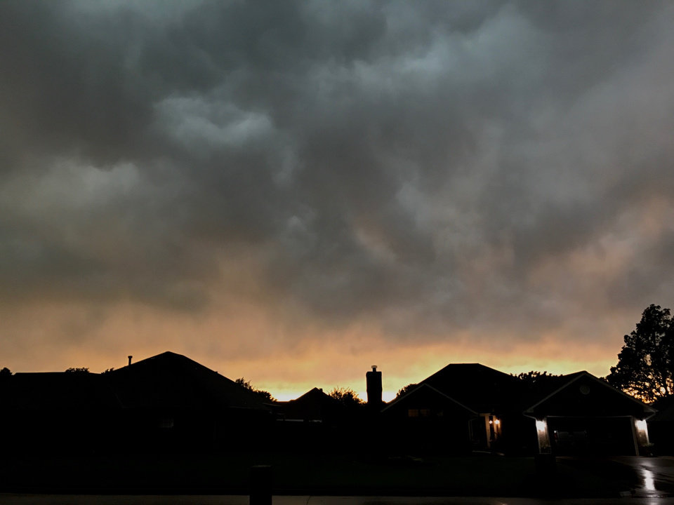 Photo - View of clouds looking into sunset as storm passes over east side of Oklahoma County Thursday night, May 18, 2017. Photo by Jim Beckel/ The Oklahoman