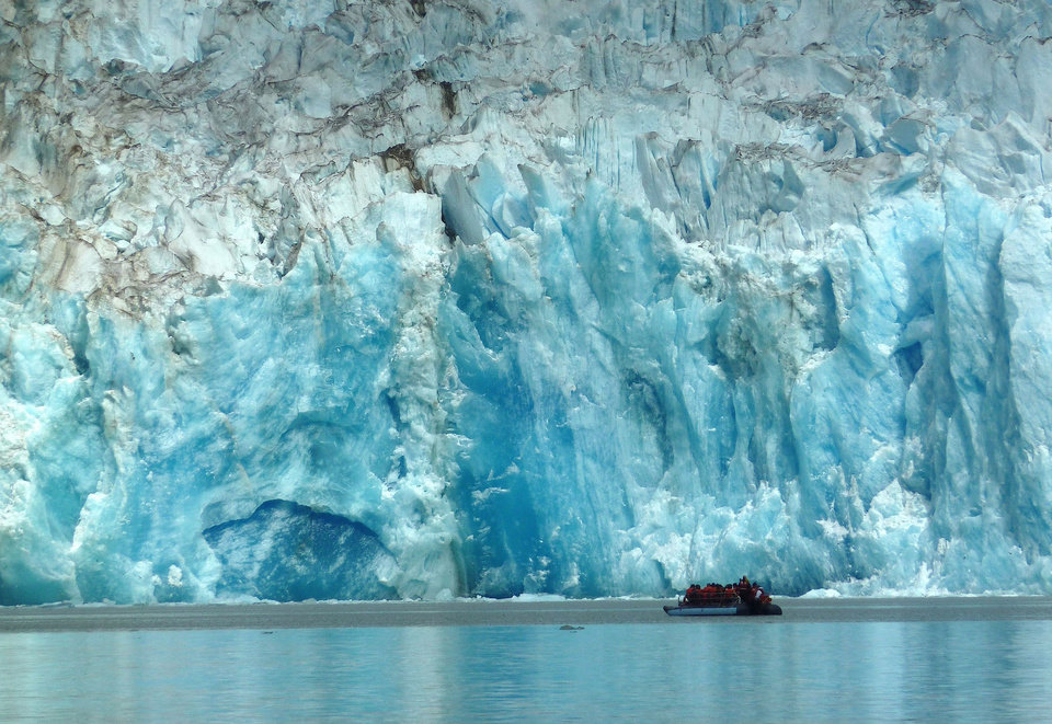 Photo -  Passengers aboard the Wilderness Discoverer get a close-up view of glaciers along Alaska's Inside Passage. Photo courtesy of Jim Farber.