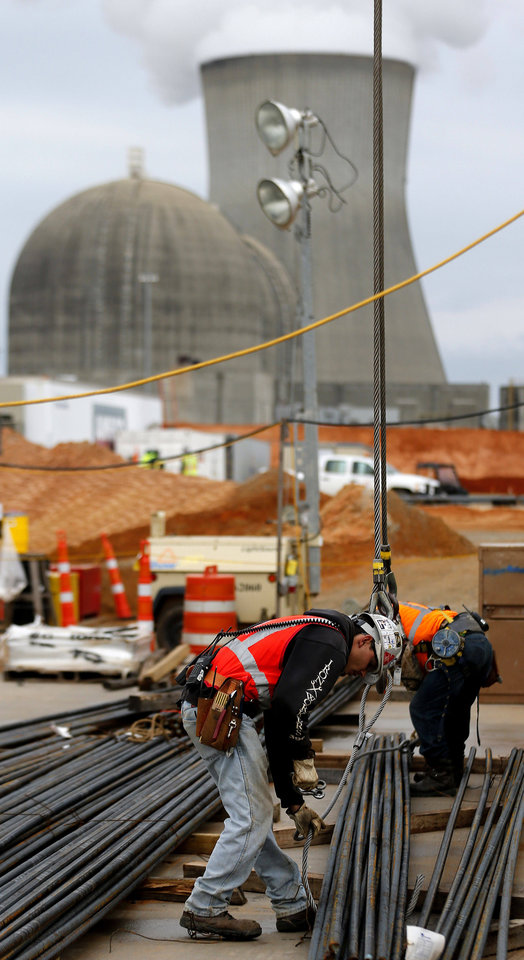 In this photo taken Monday, Dec. 11, 2012  an man works on a new nuclear reactor at the Plant Vogtle nuclear power plant in Augusta, Ga.,  Atlanta-based Southern Co. planned to have the first of its new reactors at the plant built by April 1, 2016. A second reactor in eastern Georgia was supposed to come online the following year  but it could take at least a year longer than expected and involve hundreds of millions of dollars in extra costs. (AP Photo/John Bazemore)