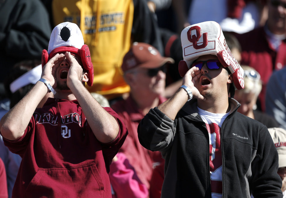 Oklahoma fans cheer before the college football game between the University of Oklahoma Sooners (OU) and the University of Kansas Jayhawks (KU) at Memorial Stadium in Lawrence, Kan., Saturday, Oct. 19, 2013. OU won 34-19. Photo by Sarah Phipps, The Oklahoman