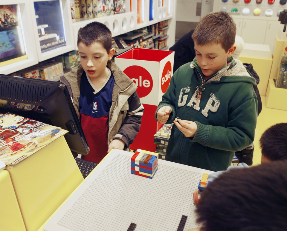Photo - Seven year old Austin Finley (left) and his brother Andrew, 8, play at the Lego Store at Penn Square Mall in Oklahoma City, OK, Thursday, Feb. 3, 2011. By Paul Hellstern, The Oklahoman