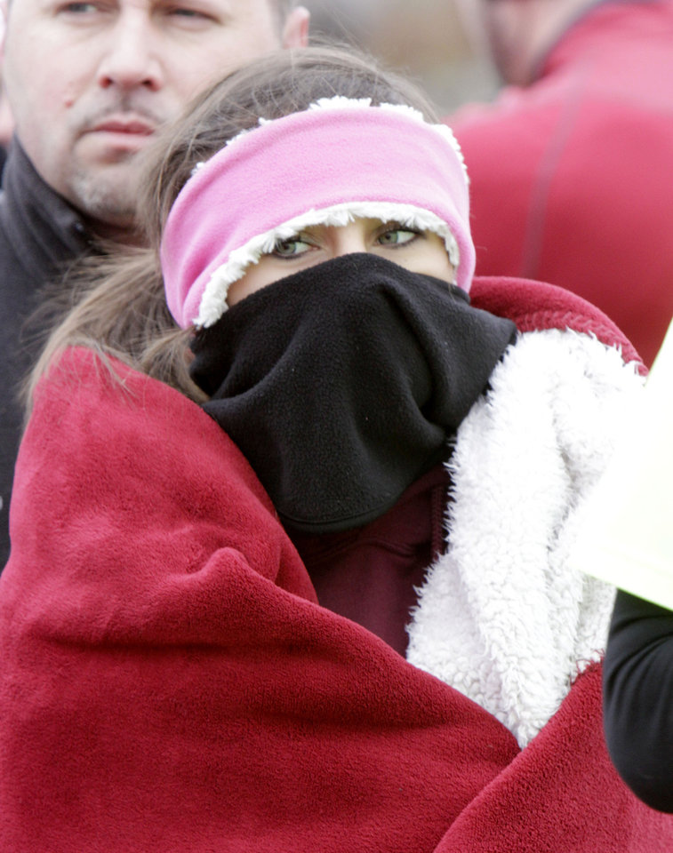 Kylie Gaede stays bundled up against the cold before beginning the Frigid Five Mile Run at Mitch Park in Edmond, OK, Saturday, Feb. 11, 2012. By Paul Hellstern, The Oklahoman