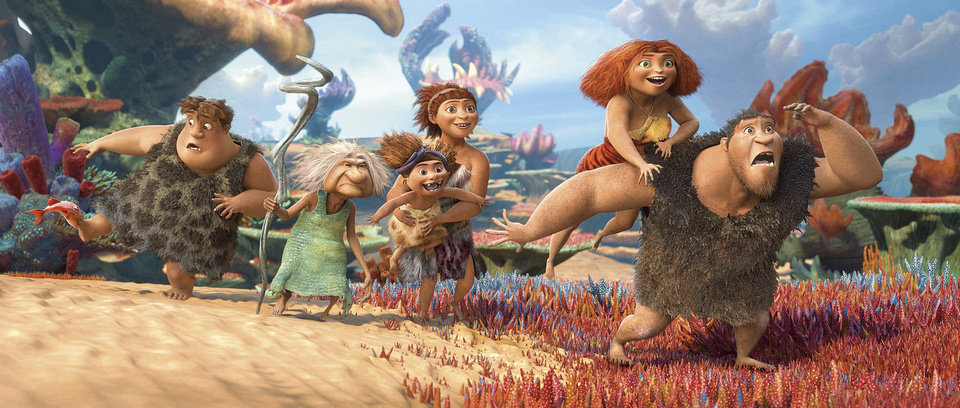 "From left, Thunk, voiced by Clark Duke, Gran, voiced by Cloris Leachman, Ugga, voiced by Catherine Keener, who is holding Sandy, voiced by Randy Thom, Eep, voiced by Emma Stone and Grug, voiced by Nicolas Cage, in a scene from ""The Croods."" DREAMWORKS ANIMATION PHOTO <strong></strong>"