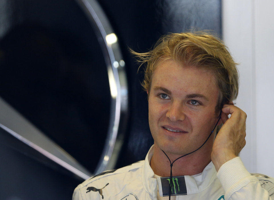 Photo - Mercedes driver Nico Rosberg of Germany adjusts his ear plugs during the free practice at the Hungarian Formula One Grand Prix in Budapest, Hungary, Friday, July 25, 2014. The Hungarian Grand Prix will be held on Sunday, July 27, 2014. (AP Photo/Darko Vojinovic)