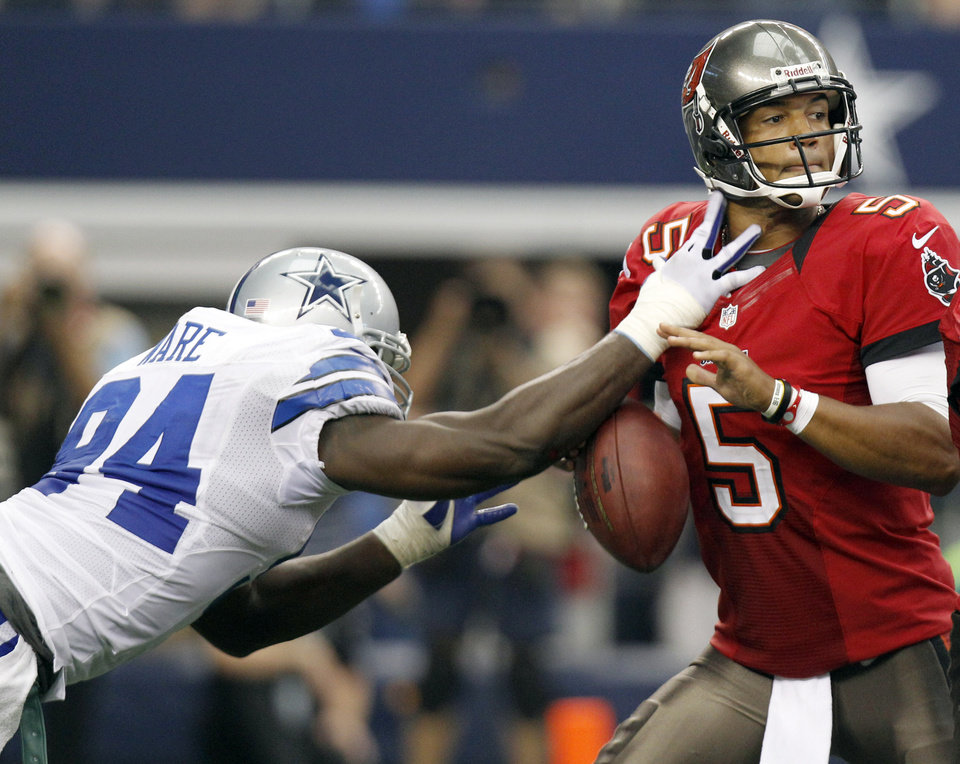Dallas Cowboys outside linebacker DeMarcus Ware (94) strips the ball from Tampa Bay Buccaneers quarterback Josh Freeman (5) during the second half of an NFL football game on Sunday, Sept. 23, 2012, in Arlington, Texas. (AP Photo/LM Otero)