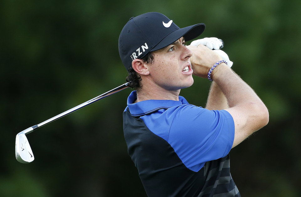 Photo - Rory McIlroy tees off on the third hole during the final round of the Deutsche Bank Championship golf tournament in Norton, Mass., Monday, Sept. 1, 2014. (AP Photo/Michael Dwyer)