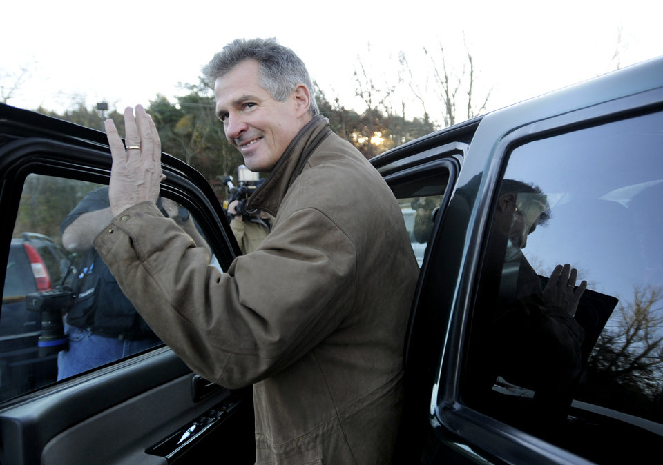 U.S. Sen. Scott Brown, R-Mass., gets into his truck after voting in Wrentham, Mass., on Election Day, Tuesday, Nov. 6, 2012. Brown is facing Democratic candidate Elizabeth Warren for the U.S. Senate. (AP Photo/Gretchen Ertl)