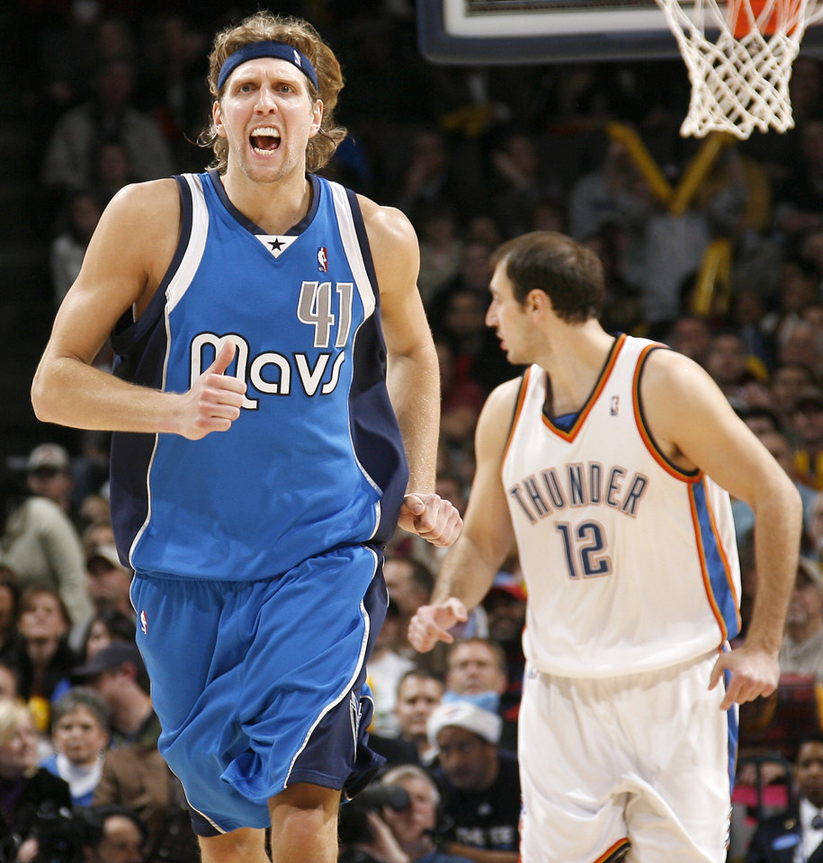 Photo - Dirk Nowitzki of Dallas reacts after a basket during the NBA basketball game between the Oklahoma City Thunder and the Dallas Mavericks at the Ford Center in Oklahoma City on Wednesday, December 16, 2009. Photo by Bryan Terry, The Oklahoman