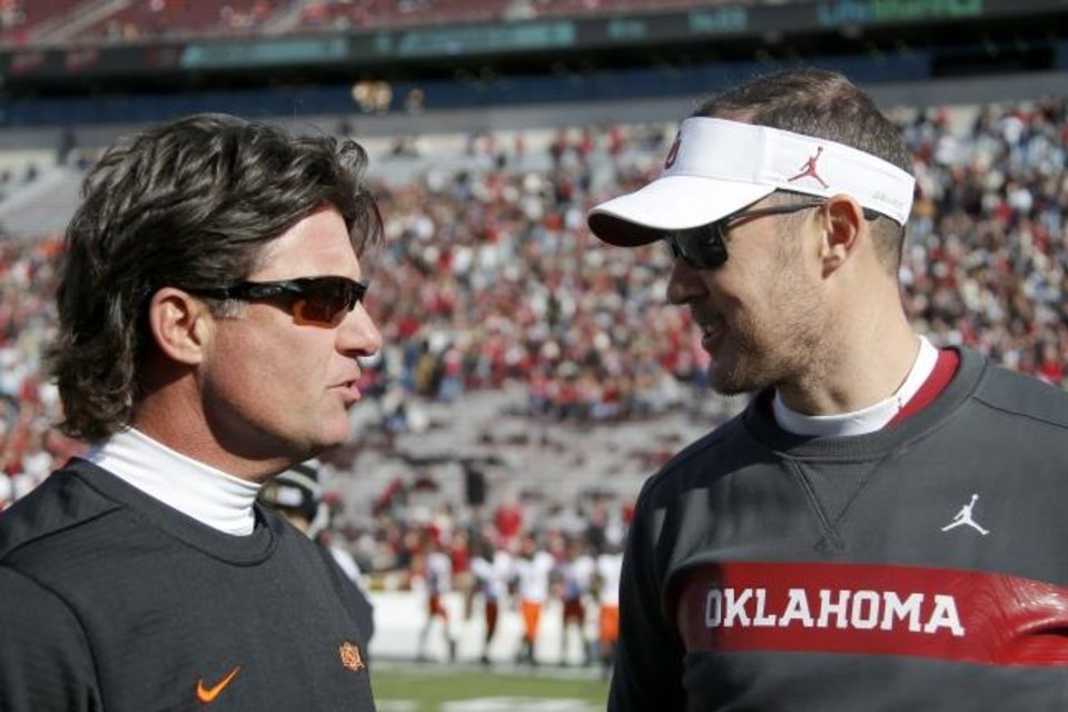 Photo -  Coaches Mike Gundy of OSU (left) and Lincoln Riley of OU chat before the 2018 Bedlam game. [Bryan Terry/The Oklahoman]