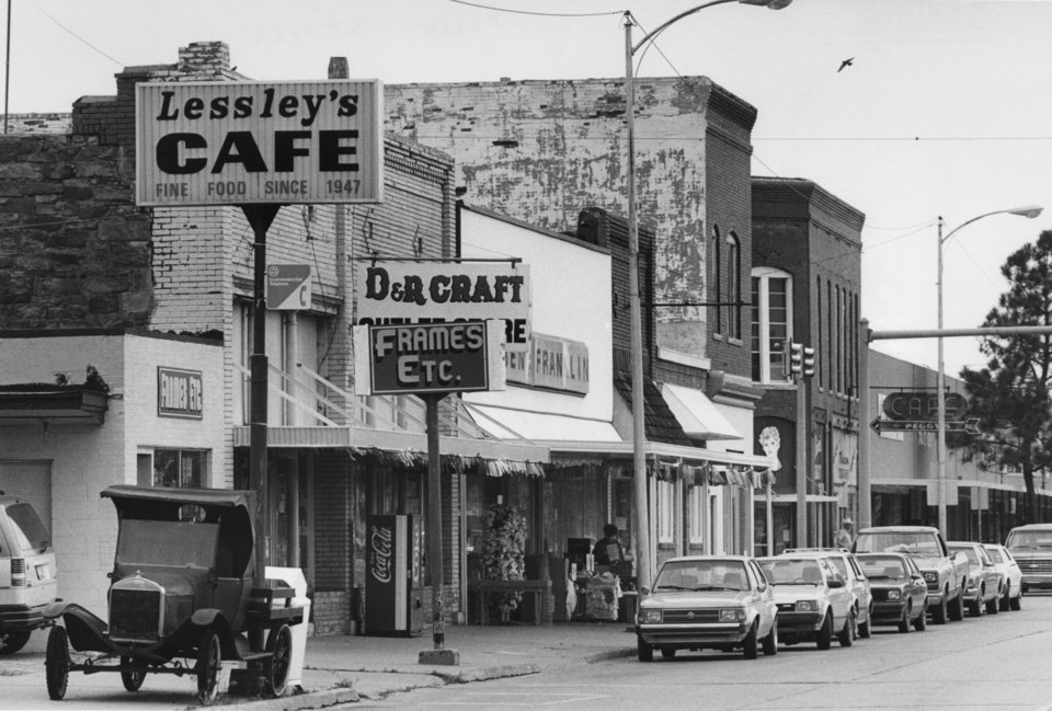 """STREET SCENES / SMALL TOWNS:  """"Small shops and cafes dot Sallisaw's main street.""""  Original dated 4/30/1990.  Photo by Staff Photographer David McDaniel."""
