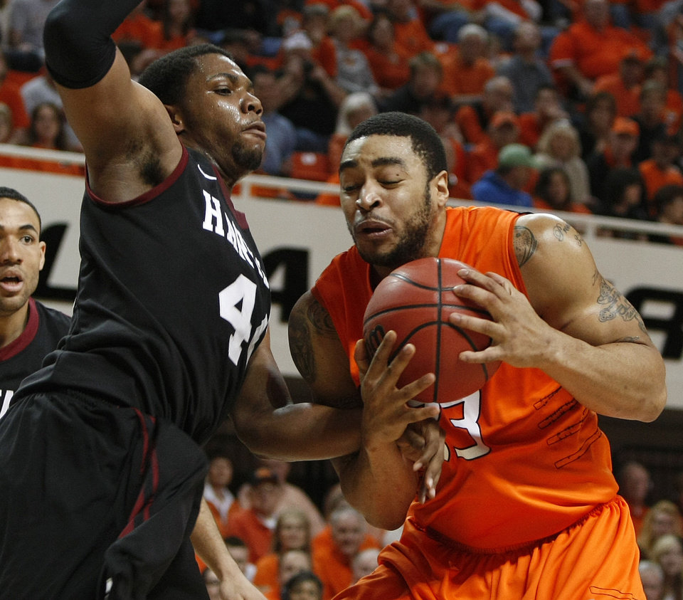 Oklahoma State\'s Marshall Moses (33) tries to get past Harvard\'s Keith Wright (44) during a first round NIT game on Tuesday. Photo by Bryan Terry, The Oklahoman