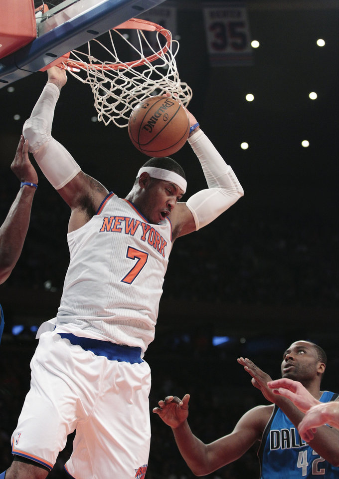 Photo -   New York Knicks' Carmelo Anthony (7) dunks in front of Dallas Mavericks' Elton Brand during the first half of an NBA basketball game Friday, Nov. 9, 2012, in New York. (AP Photo/Frank Franklin II)