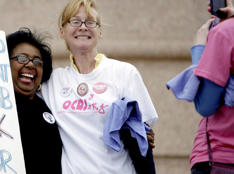 Photo - Sen. Judy Eason McIntyre poses with a protestor during a rally opposing the Personhood measures at the state Capitol, Tuesday, Feb. 28, 2012. Photo by Sarah Phipps, The Oklahoman
