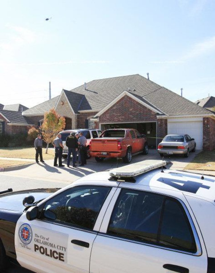 Oklahoma City police investigate a home invasion Friday. Photo by David McDaniel, The Oklahoman