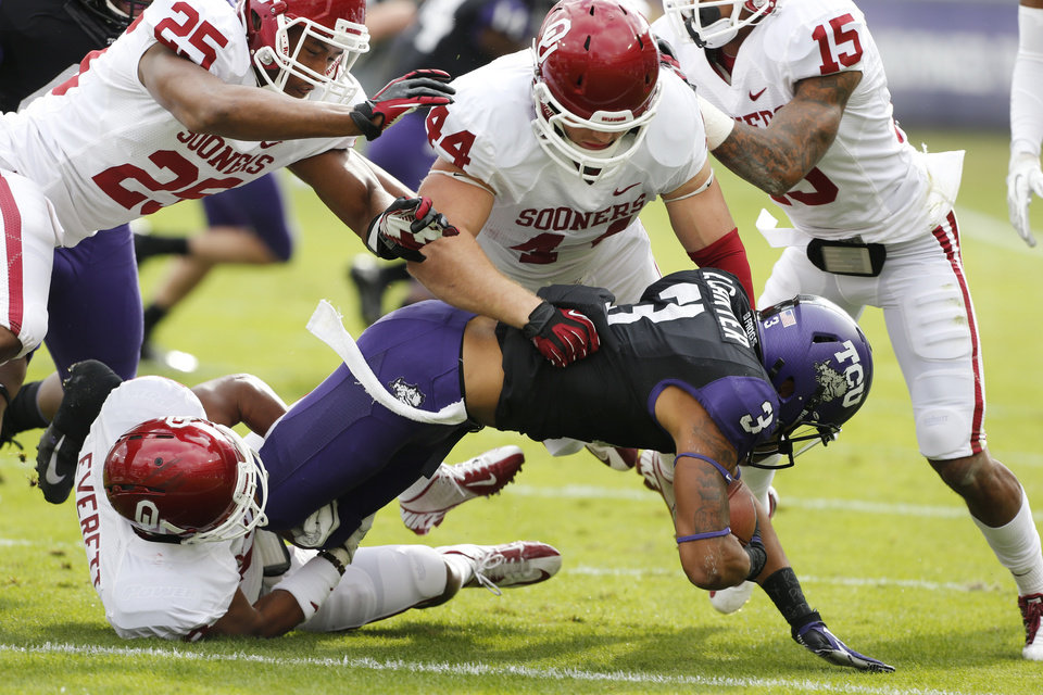 Oklahoma's Aaron Franklin (25), Jaydan Bird (44) and Kass Everett (23) bring down TCU's Brandon Carter (3) during the college football game between the University of Oklahoma Sooners (OU) and the Texas Christian University Horned Frogs (TCU) at Amon G. Carter Stadium in Fort Worth, Texas, on Saturday, Dec. 1, 2012. Photo by Steve Sisney, The Oklahoman