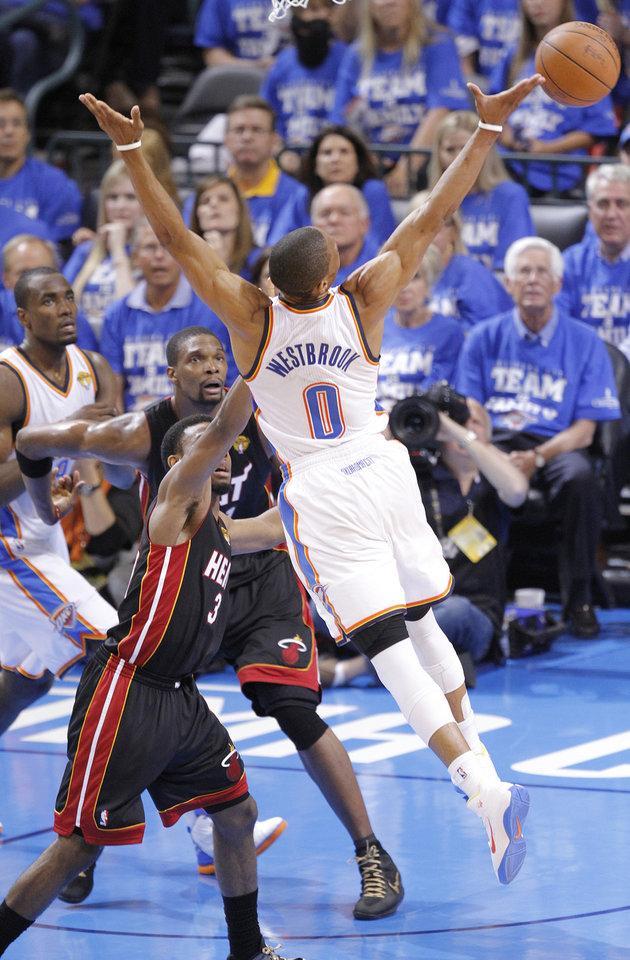 Photo - Oklahoma City's Russell Westbrook (0) looses the ball past Miami's Dwyane Wade (3) during Game 2 of the NBA Finals between the Oklahoma City Thunder and the Miami Heat at Chesapeake Energy Arena in Oklahoma City, Thursday, June 14, 2012. Photo by Chris Landsberger, The Oklahoman