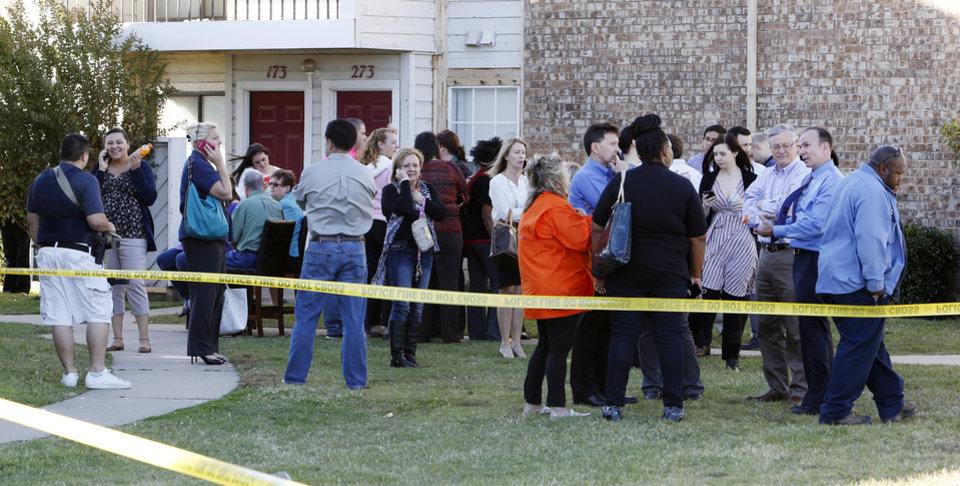 Photo - Workers from a nearby office buildings wait in a holding area at the Apple Creek Apartments near the scene of a hostage situation at Nextep in Norman Monday, Nov. 10, 2014.  Photo by Paul B. Southerland, The Oklahoman