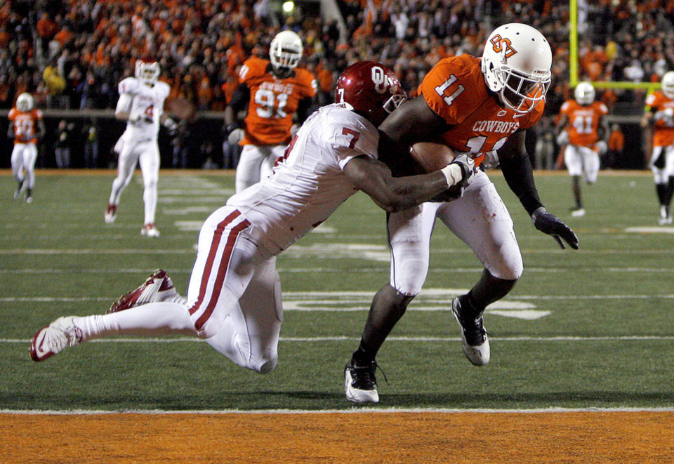 Photo - Oklahoma State's Shaun Lewis ( 11) scores as touchdown of a interception as Oklahoma's Demarco Murray (7) tackles him during the Bedlam college football game between the University of Oklahoma Sooners (OU) and the Oklahoma State University Cowboys (OSU) at Boone Pickens Stadium in Stillwater, Okla., Saturday, Nov. 27, 2010. Photo by Sarah Phipps, The Oklahoman