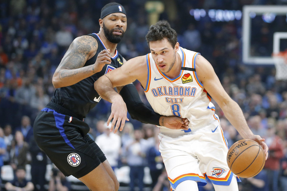 Photo - Oklahoma City's Danilo Gallinari (8) goes past LA's Marcus Morris Sr. (31) during an NBA basketball game between the Oklahoma City Thunder and the Los Angeles Clippers at Chesapeake Energy Arena in Oklahoma City, Tuesday, March 3, 2020. [Bryan Terry/The Oklahoman]
