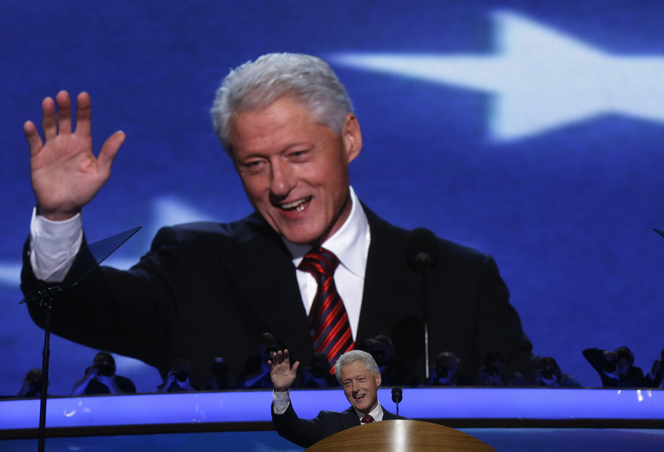 Photo - Former President Bill Clinton addresses the Democratic National Convention in Charlotte, N.C., on Wednesday, Sept. 5, 2012. (AP Photo/Charles Dharapak)  ORG XMIT: DNC774