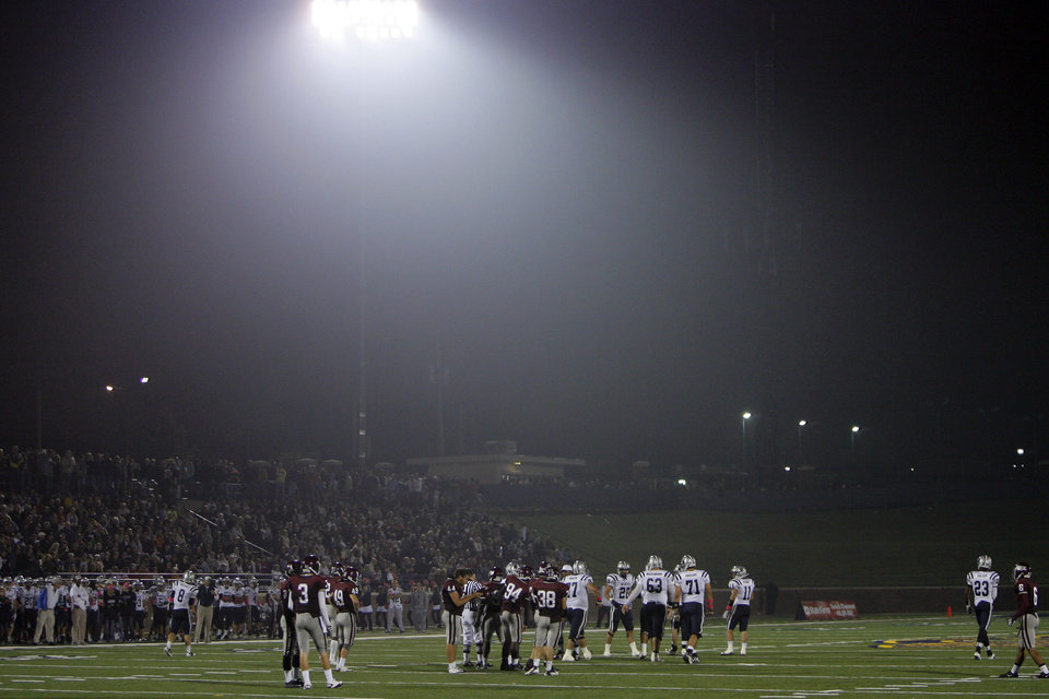 Photo - Fog rolls into Wantland Stadium during the high school football game between Edmond North and Edmond Memorial in Edmond, Okla., Friday, Sept. 16, 2011. Photo by Sarah Phipps, The Oklahoman