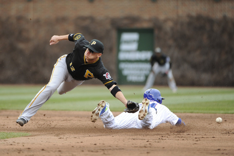 Photo - Chicago Cubs' Emilio Bonifacio steals second base as Pittsburgh Pirates shortstop Clint Barmes (12) misses the throw during the third inning of a baseball game, Thursday, April 10, 2014 in Chicago.  (AP Photo/David Banks)