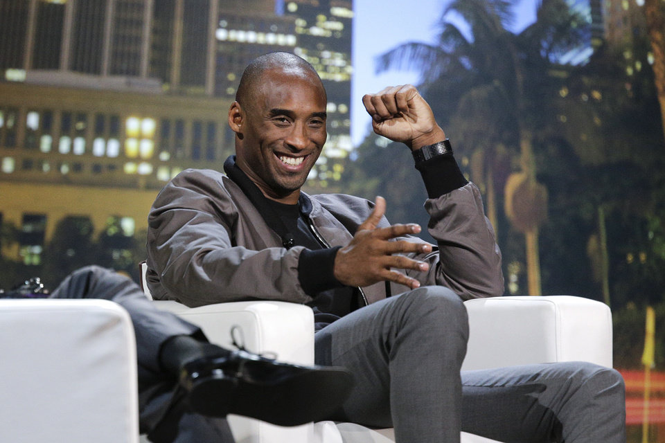 Photo - Los Angeles Lakers' Kobe Bryant smiles during a one-on-one conversation with talk show host Jimmy Kimmel at Nokia Theatre on Thursday, Aug. 15, 2013, in Los Angeles. The event was held to raise money toward eliminating homelessness in the Los Angeles area. (AP Photo/Jae C. Hong)