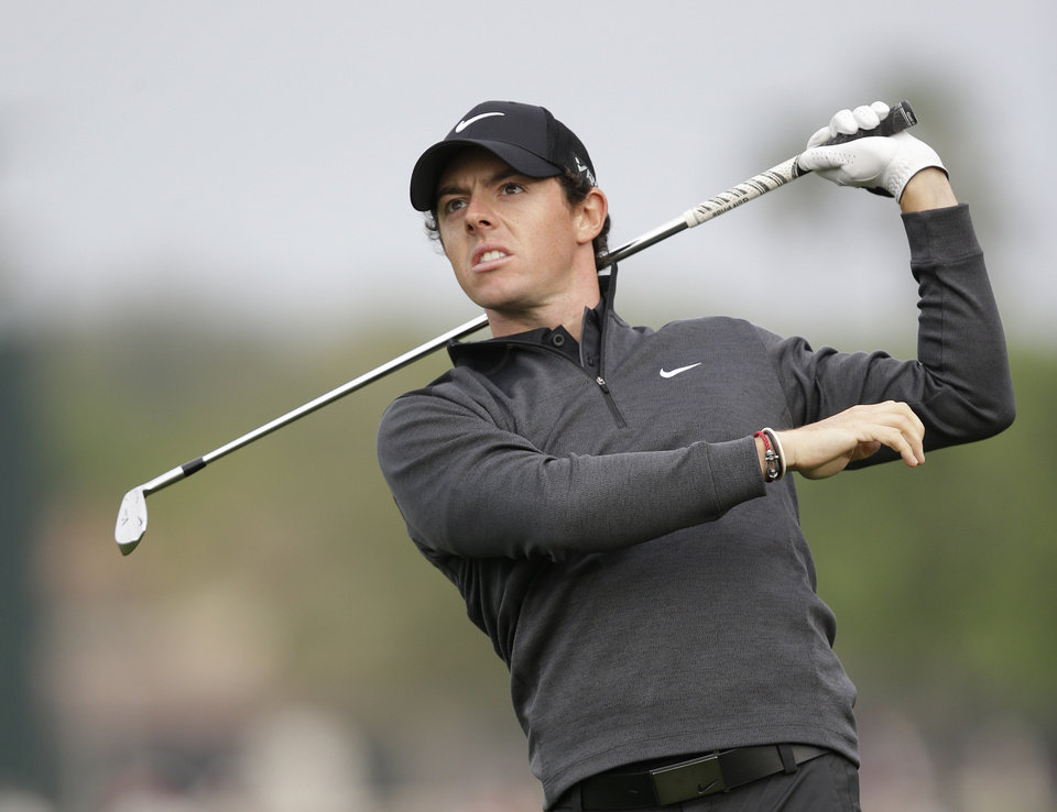 Photo - Golfer Rory McIlroy of Northern Ireland, watches his shot on the 12th hole during the second round of the Honda Classic golf tournament, Friday, Feb. 28, 2014 in Palm Beach Gardens, Fla. (AP Photo/Wilfredo Lee)