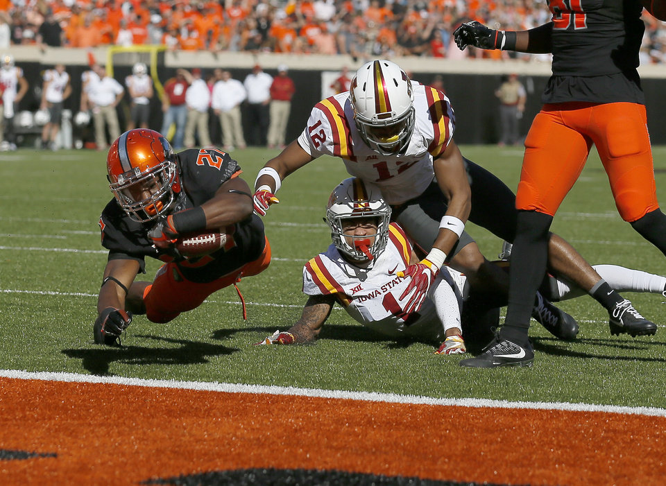 Photo - Oklahoma State's Justice Hill (27) dives for a touchdown in front of Iowa State's D'Andre Payne (1) and Jarnor Jones (12) in the second quarter during a college football game between the Oklahoma State University Cowboys (OSU) and the Iowa State University at Boone Pickens Stadium in Stillwater, Okla., Saturday, Oct. 8, 2016. Photo by Sarah Phipps, The Oklahoman