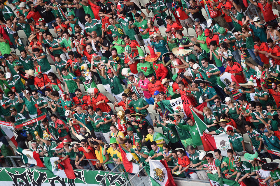 Photo - Mexico fans stand on the tribune prior to the group A World Cup soccer match between Brazil and Mexico at the Arena Castelao in Fortaleza, Brazil, Tuesday, June 17, 2014.  (AP Photo/Francois Xavier Marit, pool)