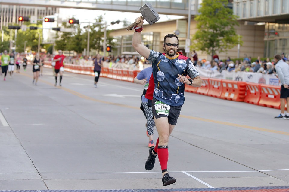 Photo - David Theriot crosses the finish line during the Oklahoma City Memorial Marathon in Oklahoma City, Sunday, April 28, 2019. [Bryan Terry/The Oklahoman]