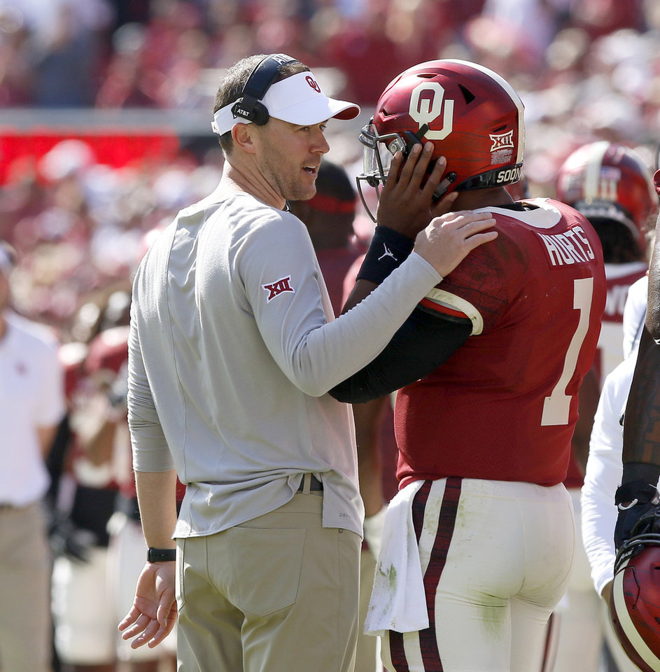 Photo - Oklahoma coach Lincoln Riley talks with Jalen Hurts (1) during a college football game between the University of Oklahoma Sooners (OU) and the West Virginia Mountaineers at Gaylord Family-Oklahoma Memorial Stadium in Norman, Okla, Saturday, Oct. 19, 2019. Oklahoma won 52-14. [Bryan Terry/The Oklahoman]