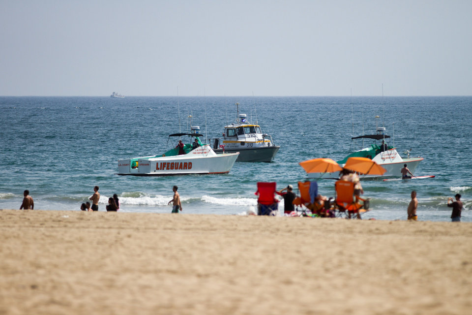 Photo - CORRECTS PHOTOGRAPHER'S NAME Lifeguard rescue boats patrol off the shore at Venice Beach, Sunday, July 27, 2014 in Los Angeles. Authorities said lightning struck 14 people, leaving two critically injured, as rare summer thunderstorms swept through Southern California on Sunday. (AP Photo/Steve Christensen)