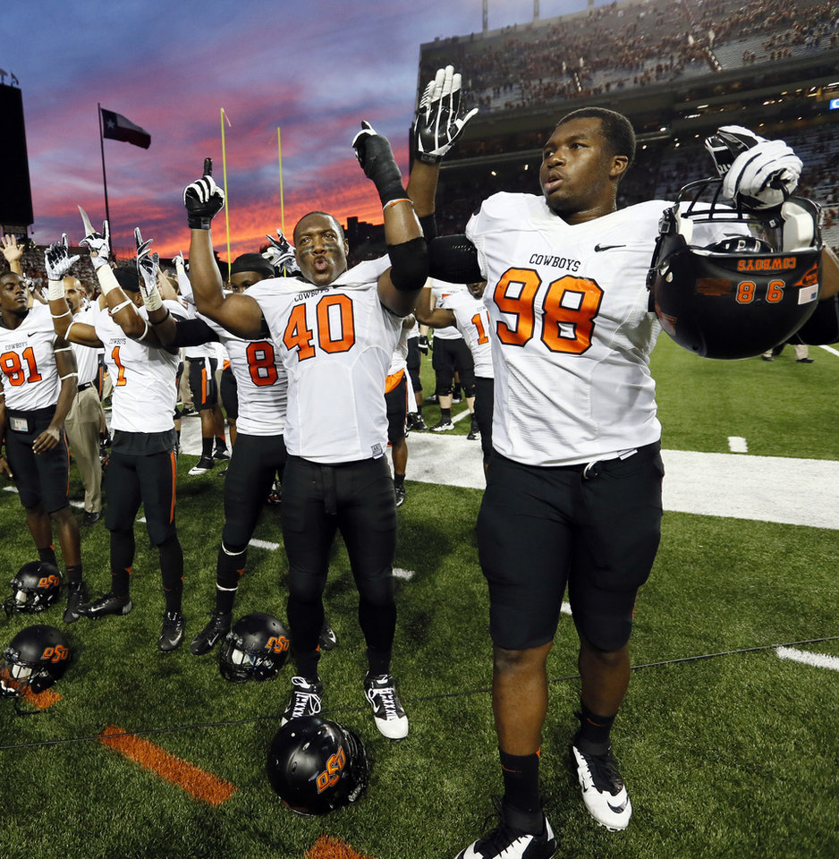 OSU players sing the alma mater, including Tyler Johnson (40) and Davidell Collins (98), after a college football game between the Oklahoma State University Cowboys (OSU) and the University of Texas Longhorns (UT) at Darrell K Royal - Texas Memorial Stadium in Austin, Texas, Saturday, Nov. 16, 2013. OSU won, 38-13. Photo by Nate Billings, The Oklahoman