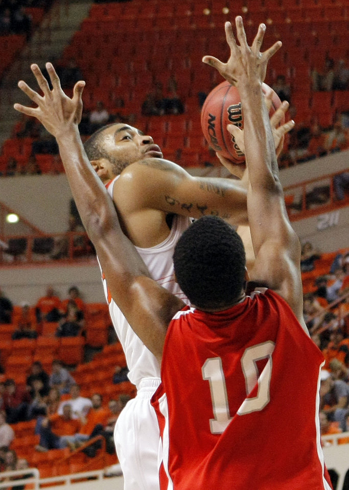 Photo - OSU's Marshall Moses (33) takes a shot over Elridge Moore (10) of Nicholls State during the men's college basketball game between Nicholls State University and Oklahoma State University at Gallagher-Iba Arena in Stillwater, Okla., Saturday, Nov. 21, 2010. OSU won, 76-56. Photo by Nate Billings, The Oklahoman