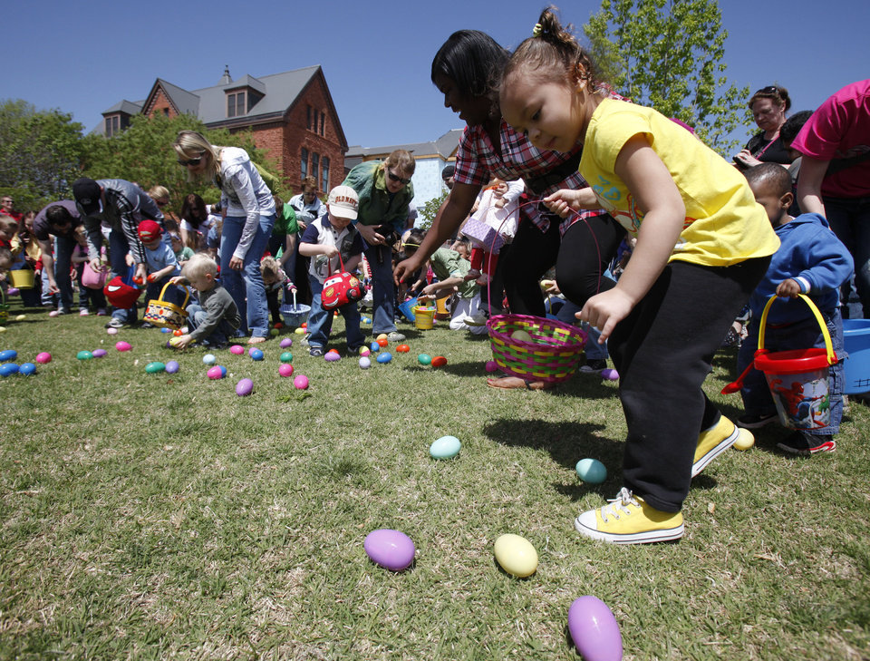 Photo - Children rush the field to pick up Easter eggs during the UCO Easter Egg Hunt and Carnival at Plunkett Park on the campus of the University of Central Oklahoma in Edmond OK, Saturday, April 16, 2011. By Paul Hellstern, The Oklahoman