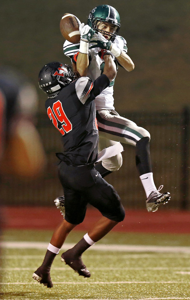 Photo - Westmoore's Giavonni Knight is called for pass interference on Norman North's Jake Higginbotham during a high school football game in Moore, Okla., Thursday, September 13, 2012. Photo by Bryan Terry, The Oklahoman