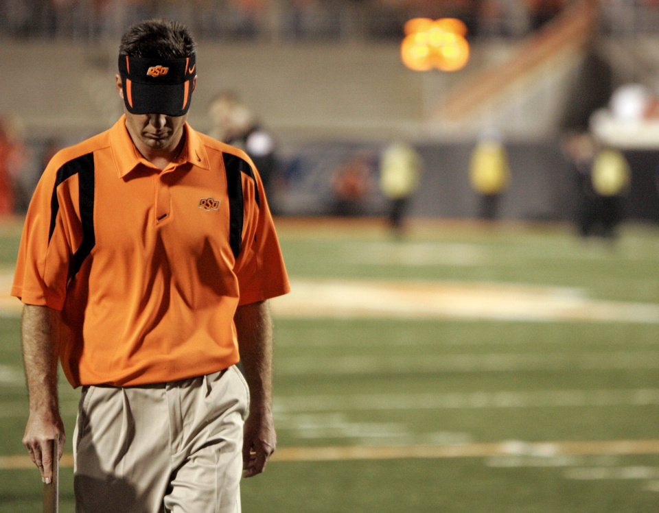 Photo - OSU head coach Mike Gundy walks off the field following the college football game between Oklahoma State University (OSU) and Kansas University (KU) at Boone Pickens Stadium in Stillwater, Okla. Saturday, Nov. 10, 2007. Kansas won 43-28. BY MATT STRASEN, THE OKLAHOMAN ORG XMIT: KOD