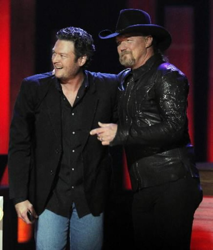 Trace Adkins delivers Oklahoma country music star Blake Shelton's invitation to join the Grand Ole Opry on Sept. 28, 2010, in Nashville, Tenn. Shelton now is helping with Opry backstage tours via video. (AP file)