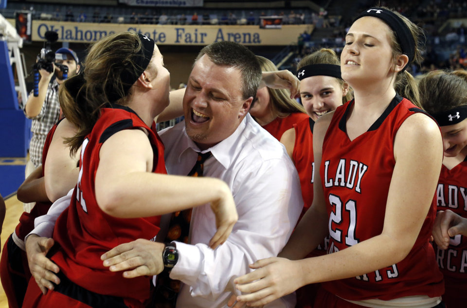 Photo - Justin Janz hugs Maranda Janz after winning the Class B girls state championship over Lomega at the State Fair Arena.,  Saturday, March 2, 2013. Photo by Sarah Phipps, The Oklahoman