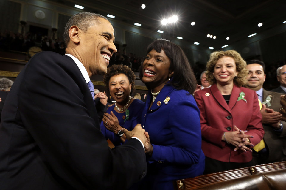 Photo - President Barack Obama is greeted before giving his State of the Union address during a joint session of Congress on Capitol Hill in Washington, Tuesday Feb. 12, 2013. (AP Photo/Charles Dharapak, Pool)