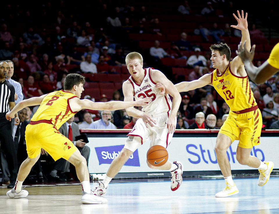 Photo - Oklahoma's Brady Manek (35) goes between Iowa State's Caleb Grill (2) and Michael Jacobson (12) during an NCAA basketball game between the University of Oklahoma Sooners (OU) and the Iowa State Cyclones at the Lloyd Noble Center in Norman, Okla., Wednesday, Feb. 12, 2020. [Bryan Terry/The Oklahoman]