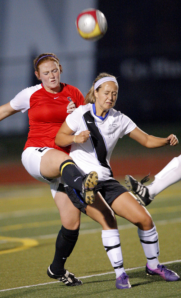 Deer Creek's Sophia Brazil and Carl Albert's Erin Davis fight for a ball during the girls 5A soccer state championship game between Deer Creek and Carl Albert at Edmond North High School in Edmond, Okla., Saturday, May 12, 2012. Photo by Sarah Phipps, The Oklahoman