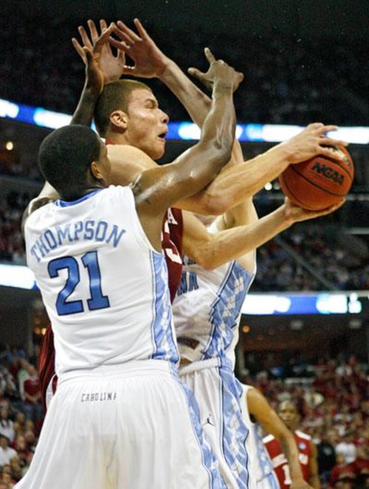 Photo -  Oklahoma's Blake Griffin (23) drives past the defense of North Carolina's Deon Thompson (21) during the first half in the Elite Eight game of NCAA Men's Basketball Regional between the University of North Carolina and the University of Oklahoma at the FedEx Forum on Sunday, March 29, 2009, in Memphis, Tenn.  PHOTO BY CHRIS LANDSBERGER, THE OKLAHOMAN