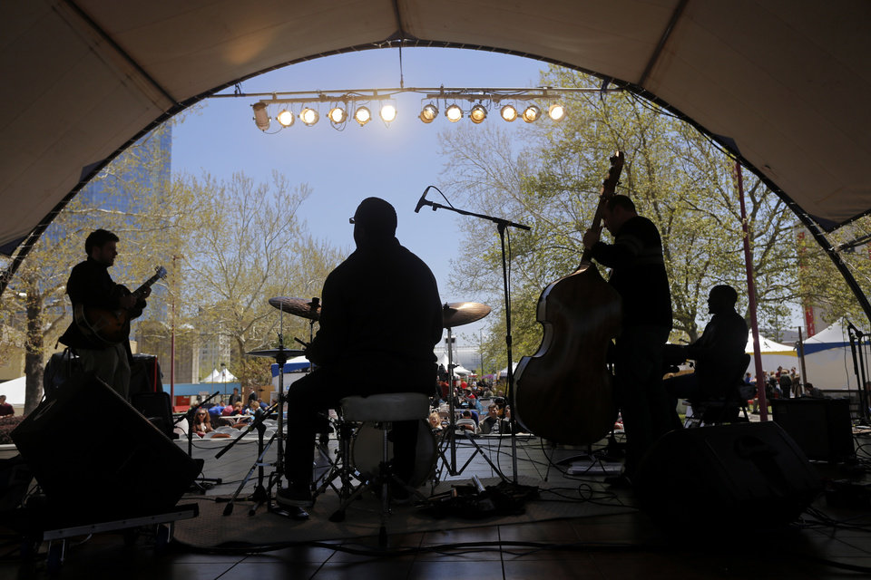 Photo - The jazz band New Growth plays on the Cafe Stage at noon at the Festival of the Arts in downtown Oklahoma City  Wednesday, April 24, 2013. The Hunters are from Piedmont. Photo by Doug Hoke, The Oklahoman
