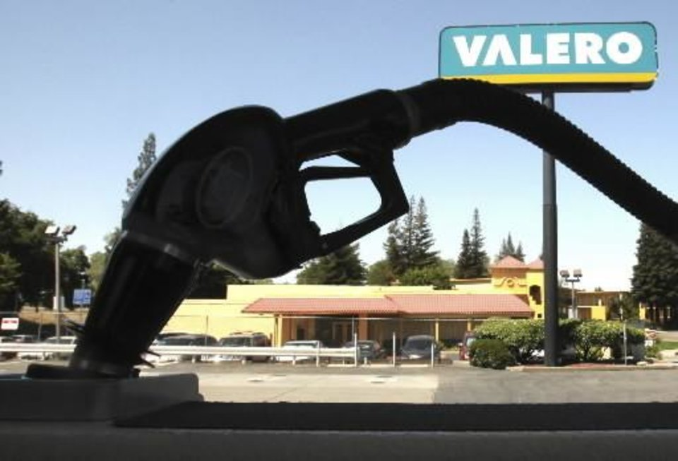 Photo - In this May 12, 2009 file photo, a gas nozzle is seen filling Joseph Bergh's 22-foot fishing boat at a  Valero gas station in Sacramento, Calif. (AP Photo/Rich Pedroncelli, file)