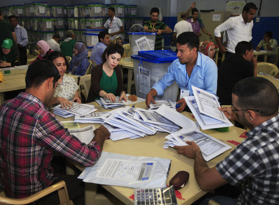 Photo - Electoral workers count ballots at a counting center in Baghdad, Iraq, Sunday, April 21, 2013. Iraqis have begun counting votes from the first provincial elections since the last U.S. troops withdrew in December 2011. (AP Photo/ Karim Kadim)