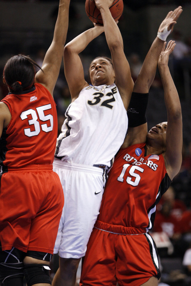 Photo - Lindsay Wisdom-Hylton (32) shoots between Brittany Ray (35) and Kia Vaughn (15) in the first half of the NCAA women's basketball tournament game between Rutgers and Purdue at the Ford Center in Oklahoma City, Okla. on Sunday, March 29, 2009. 